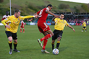 Whitehawk striker Danny Mills battles with Ebbsfleet Sam Deering during the National League South Play Off 1st Leg match between Whitehawk FC and Ebbsfleet United at the Enclosed Ground, Whitehawk, United Kingdom on 4 May 2016. Photo by Phil Duncan.
