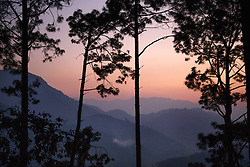 Sunset through the trees in the Kagati village.<br />