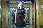 Orthopedic surgeon Tessa Balach stands in front of the OR hallway in the Bliss Building of Hartford Hospital.