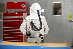 "Ford is expanding its efforts to design and produce urgently needed medical equipment and supplies for health care workers, first responders and patients fighting coronavirus.<br /> <br /> In addition to the current production of more than 3 million face shields in Plymouth, Mich., Ford-designed powered air-purifying respirator production begins Tuesday, April 14. Ford also is now producing face masks and leading an effort to scale production of reusable gowns for health care workers. Lastly, Ford started providing manufacturing expertise to help scientific instrument provider Thermo Fisher Scientific quickly expand production of COVID-19 collection kits to test for the virus.<br /> <br /> ""We knew that to play our part helping combat coronavirus, we had to go like hell and join forces with experts like 3M to expand production of urgently needed medical equipment and supplies, said Jim Baumbick, vice president, Ford Enterprise Product Line Management. ""In just three weeks under Project Apollo, we've unleashed our world-class manufacturing, purchasing and design talent to get scrappy and start making personal protection equipment and help increase the availability and production of ventilators.""<br /> <br /> Ford and 3M Collaboration Leads to New PAPR<br /> Since late March, Ford manufacturing, purchasing and supply chain experts have been embedded at 3M manufacturing facilities to help increase production of urgently needed products.<br /> <br /> With this additional help, 3M and Ford were able to increase the output of PAPRs and N95 respirators at 3M's U.S.-based manufacturing facilities. <br /> <br /> ""3M is dedicated to helping to protect our heroic health care workers and first responders globally, including sharing our scientific expertise to increase supply of needed PPE,"" said Bernard Cicut, vice president, 3M Personal Safety Division. ""We are proud to stand together with Ford in this effort, as they have helped us increase manufacturing of existing 3M PPE products and, together, we have rapidly designed a n"