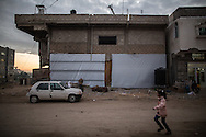 A child runs on the streets of Khuza