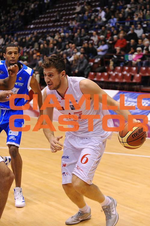 DESCRIZIONE : Milano Lega A 2011-12 EA7 Emporio Armani Milano Banco di Sardegna Sassari<br /> GIOCATORE : Stefano Mancinelli<br /> CATEGORIA : Palleggio<br /> SQUADRA : EA7 Emporio Armani Milano<br /> EVENTO : Campionato Lega A 2011-2012<br /> GARA : EA7 Emporio Armani Milano Banco di Sardegna Sassari<br /> DATA : 12/02/2012<br /> SPORT : Pallacanestro<br /> AUTORE : Agenzia Ciamillo-Castoria/A.Dealberto<br /> Galleria : Lega Basket A 2011-2012<br /> Fotonotizia : Milano Lega A 2011-12 EA7 Emporio Armani Milano Banco di Sardegna Sassari<br /> Predefinita :