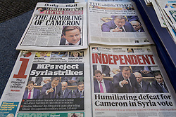 © licensed to London News Pictures. London, UK 30/08/2013. Front pages of national newspapers show MPs decision against possible military action against Syria at a newsagent in central London. Photo credit: Tolga Akmen/LNP