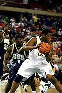 25 November 2005: Marquette's Dwight Burke (12) tries to spin around ORU's Ken Tutt (1) in the Marquette University 73-70 victory over Oral Roberts University at the Great Alaska Shootout in Anchorage, Alaska