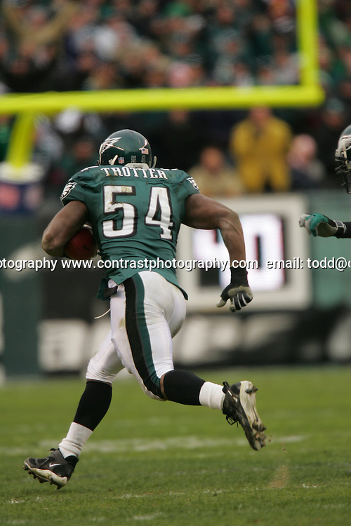 16 Jan 2005:Jeremiah Trotter of the Philadelphia Eagles running after intercepting a pass from Daunte Culpepper during the Philadelphia Eagles 27-14 victory over the Minnesota Vikings at Lincoln Financial Field in Philadelphia, PA. <br />
