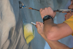 Cleaning of climbing wall at World cup competition in Zlato polje, Kranj, Slovenia, on November 15, 2008.  (Photo by Vid Ponikvar / Sportida)