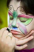 Young girl of 6 having a butterfly madeup on her face