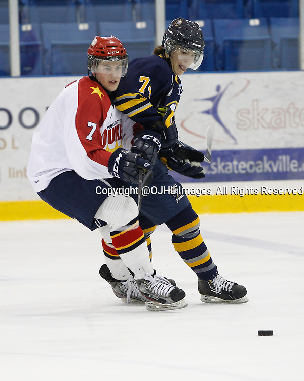 OAKVILLE, ON - Sep 28, 2014 :  Ontario Junior Hockey League game action between Wellington and Buffalo at the Governor's Showcase Tournament. Luc Brown #7 and Justin Cmunt #74 skate after the puck during the first period.<br /> (Photo by Tim Bates / OJHL Images)