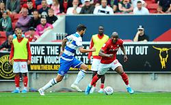 Benik Afobe of Bristol City tries to get past Jordan Hugill of Queens Park Rangers- Mandatory by-line: Nizaam Jones/JMP - 17/08/2019 - FOOTBALL - Ashton Gate - Bristol, England - Bristol City v Queens Park Rangers - Sky Bet Championship