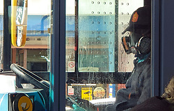 © Licensed to London News Pictures. 06/04/2020. London, UK. A London bus driver wearing a face mask during the coronavirus outbreak. Five bus drivers have lost their lives from the virus and according to the Unite union, bus drivers are 'scared to death' of catching coronavirus as they still don't have full hygiene measures in place. Photo credit: Dinendra Haria/LNP
