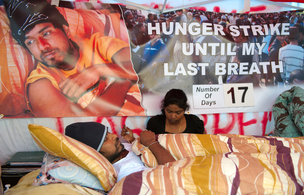 Tamil demonstrator Parameswaran Subramaniyan, 28, enters the seventeenth day of his hunger strike outside Britain's Houses of Parliament in London, on April 23, 2009. Thousands of Tamils blocked some of London's busiest roads Monday, demonstrating outside the Houses of Parliament for an immediate ceasefire in the war between Tamil rebels and Sri Lanka's government. Subramaniyam, who has gone seventeen days without food and drink to highlight the Tamil cause, lay in a tent on a piece of land opposite Parliament. One of his supporters, 18-year-old student Janani Paramsothy, said Monday he was prepared to sacrifice his life and that other hunger strikers were prepared to take his place if he died....Standard Licence feee's apply  to all image usage.Marco Secchi - Xianpix tel +44 (0) 845 050 6211 .e-mail ms@msecchi.com .http://www.marcosecchi.com