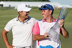 May 12, 2019 - Dallas, TX, U.S. - DALLAS, TX - MAY 12: Sung Kang and his caddie Jason Shortall celebrate with the winners trophy after the final round of the AT&T Byron Nelson on May 12, 2019 at Trinity Forest Golf Club in Dallas, TX. (Photo by Andrew Dieb/Icon Sportswire) (Credit Image: © Andrew Dieb/Icon SMI via ZUMA Press)