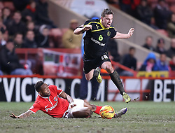 Charlton Athletic's Cedric Evina tackles Sheffield Wednesday's Chris Maguire - Photo mandatory by-line: Robin White/JMP - Tel: Mobile: 07966 386802 29/12/2013 - SPORT - FOOTBALL - The Valley - Charlton - Charlton Athletic v Sheffield Wednesday - Sky Bet Championship
