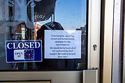 Closed sign at local Coffee shop. Shops, bars, pubs, closures due to the Covid_19 Coronavirus in, Oadby, Leicester, United Kingdom on 22 March 2020.