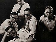 Bob Schwalberg (pipe), George Gimbel (left)
