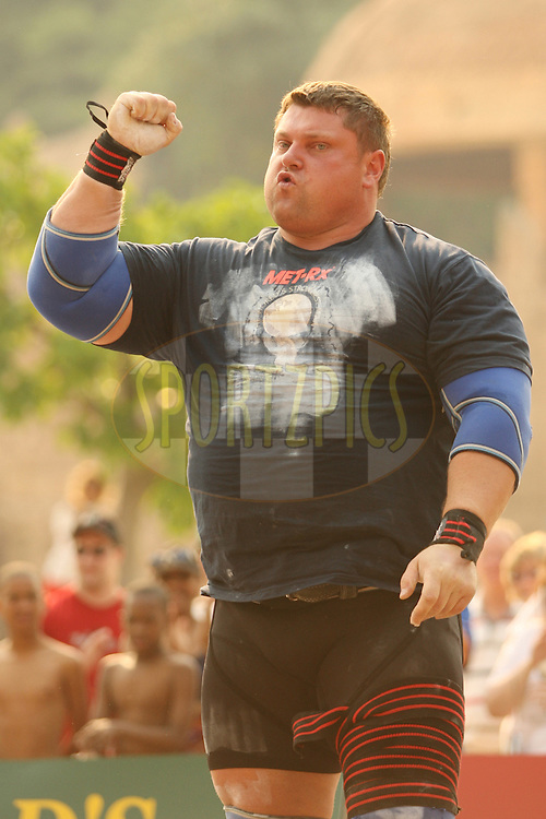 Defending champion Zydrunas Savickas (Lithuania) celebrates a successful attempt in the overhead log-lift during the final rounds of the World's Strongest Man competition held in Sun City, South Africa.
