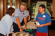 Robin Feather of the DACC (left) talks with Jeff Blumer of Bellyfire Catering during a Dayton Area Chamber of Commerce Business After Hours at the NCR Country Club in Kettering, Wednesday, July 25, 2012.  The Chamber will hold the 2012 Chamber Challenge, their 20th annual golf tournament and silent auction, at the NCR Country Club in September.