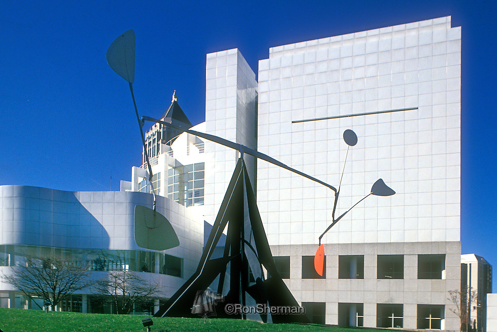 "Alexander Calder kinetic steel sculpture 'Three Up Three Down"" in fronmt of The High Museum of Art, located in Atlanta, is the leading art museum in the Southeastern United States and one of the most-visited art museums in the world. Located on Peachtree Street in Midtown, the city's arts district, the High is a division of the Woodruff Arts Center. In 2010 it had 509,000 visitors, 95th among world art museums.."