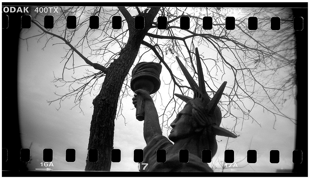 "A miniature Statue of Liberty is seen on the front lawn of ""Peace House"" in Crawford, Texas, December 13, 2008. Bush moved to the small Texas town, population 705, in 1999 during his run for the presidency in 2000. The effect of the image was achieved by shooting 35mm black and white film in a medium format camera thereby exposing the entire negative including the sprocket holes of the film. REUTERS/Jim Young"