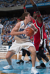 28 December 2006: North Carolina Tarheel forward (50) Tyler Hansbrough defended by Rutgers center (5) Hamady N'Diaye during a 87-48 Rutgers Scarlet Knights loss to the North Carolina Tarheels, in the Dean Smith Center in Chapel Hill, NC.<br />