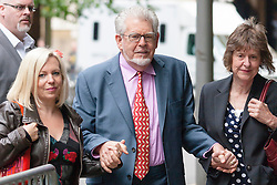 London, June 23rd 2014. Entertainer and artist Rolf Harris arrives at Southwark Crown Court with his daughter Bindi, left and his niece Jenny, where he is awaiting the jury's verdict on the 12 charges of indecent assault against 4 girls aged 7 to 19 that he faces.