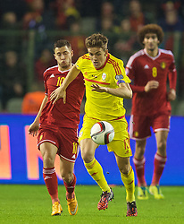 BRUSSELS, BELGIUM - Sunday, November 16, 2014: Wales' Emyr Huws and Belgium's Eden Hazard during the UEFA Euro 2016 Qualifying Group B game at the King Baudouin [Heysel] Stadium. (Pic by David Rawcliffe/Propaganda)
