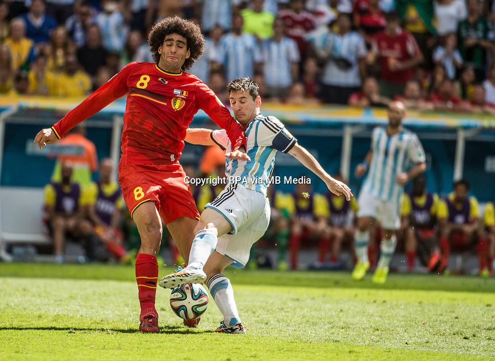 Marouane Fellaini and Lionel Messi. Argentina v Belgium, quarter-final. FIFA World Cup 2014 Brazil. National stadium, Brasilia. 05 July 2014