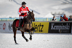 Philipp Maeder of the Switzerland going for a change of pony<br /> St.Moritz Polo World Cup On Snow 2011<br /> © Dirk Caremans