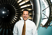 Portrait of Pratt & Whitney President David P. Hess at their facility in East Hartford, CT.  He is pictured in front of a Pratt & Whitney jet engine at their training facility in East Hartford, CT.