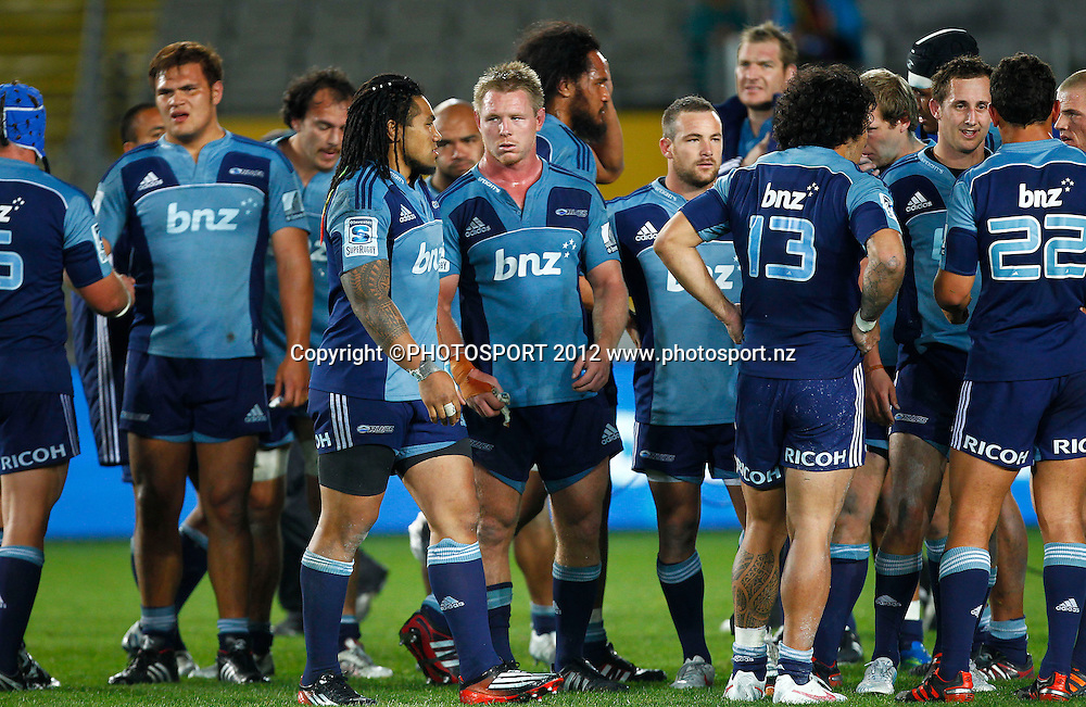 Dejected Blues players after the loss to the Reds during the Super Rugby game between The Blues and The Reds at Eden Park, Auckland, New Zealand, Friday 27 April 2012. Photo: Simon Watts / photosport.co.nz