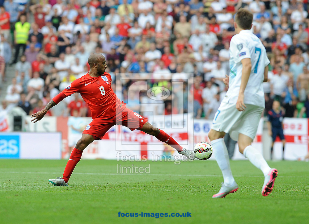 Josip Ilicic of Slovenia and Fabian Delph of England during the UEFA Euro 2016 Qualifying match at Stozice Stadium, Ljubljana<br /> Picture by Stefano Gnech/Focus Images Ltd +39 333 1641678<br /> 14/06/2015