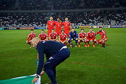 TBILSI, GEORGIA - Friday, October 6, 2017: A member of the ground staff blocks the Wales  team group photograph before the 2018 FIFA World Cup Qualifying Group D match between Georgia and Wales at the Boris Paichadze Dinamo Arena. Back row L-R: Sam Vokes, captain Ashley Williams, James Chester. Front row L-R: Tom Lawrence, Chris Gunter, Andy King, Joe Allen, goalkeeper Wayne Hennessey, Ben Davies, Aaron Ramsey and Joe Ledley. (Pic by David Rawcliffe/Propaganda)