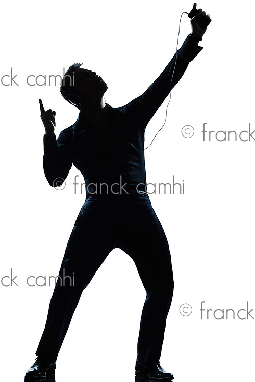 one caucasian man full length silhouette in studio isolated white background