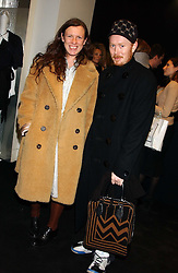 Stylist KATIE GRAND and ANDREW DAVIES at a party to celebrate The World of Alber Elbaz for Lanvin at Harvey Nichols, Knightsbridge, London on 1st February 2006.<br />