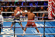 Josh Warrington and Kid Galahad attempt a punch at the same time during the IBF World Featherweight Championship between Josh Warrington and Kid Galahad at First Direct Arena, Leeds, United Kingdom on 15 June 2019.