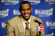 LeBron James smiles during his post game interview while talking about his half-court shot.
