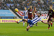 Wigan's Will Grigg (9) stretches to connect in the box during the EFL Sky Bet Championship match between Wigan Athletic and Ipswich Town at the DW Stadium, Wigan, England on 17 December 2016. Photo by Craig Galloway.