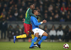 Brazil's Paulinho and Cameroon's Georges Mandjeck battle for the ball