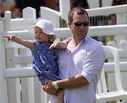 In the picture - Peter Phillips with daughter Savannah.<br /> Peter Phillips the eldest grandchild of Queen Elizabeth II and Prince Philip, Duke of Edinburgh and his wife Autumn Phillips enjoyed a family day out with their children Savannah and Isla at the Barbury International Horse trials, Marlborough, Wilts.  They enjoyed the sunshine whilst watching  Zara Phillips compete in the event.<br /> Marlborough, Wilts, United Kingdom, July 06, 2013. Photo by: i-Images