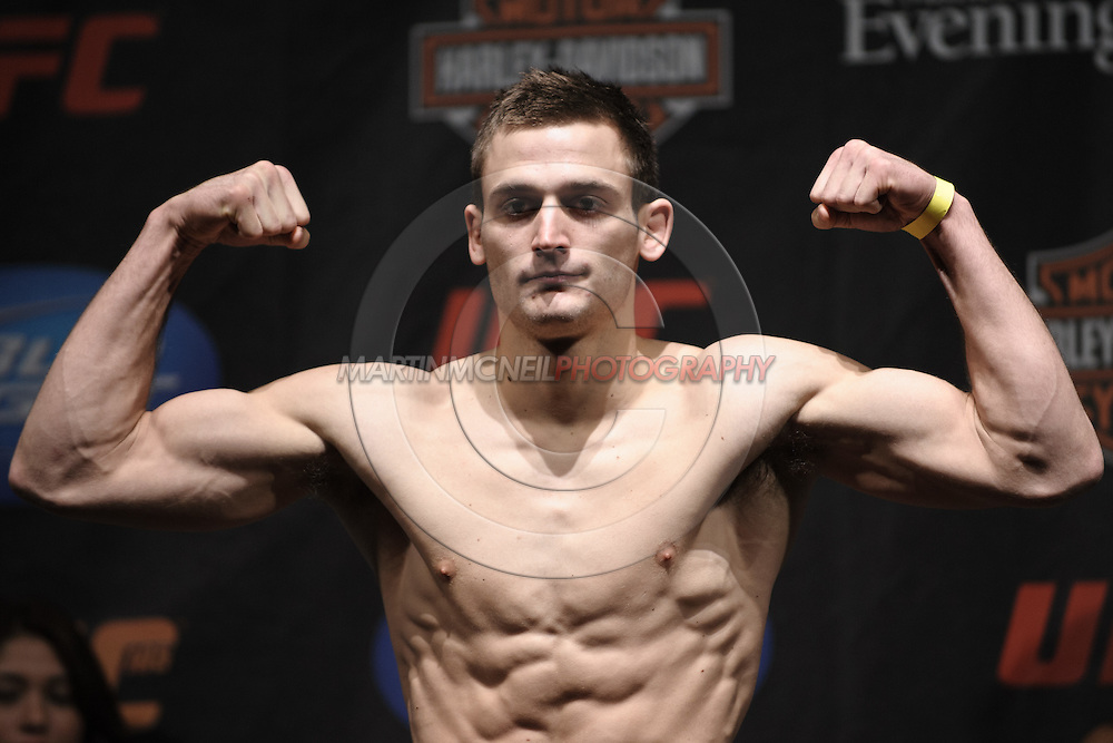 MANCHESTER, ENGLAND, NOVEMBER 13, 2009: Nick Osipczak poses on the scales during the weigh-ins for UFC 105 at the MEN Arena in Manchester, England on November 13, 2009.