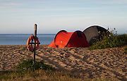 Camping on Slapton Sands, South Hams, Devon. Tents in the early morning on the pebble beach at Slapton Sands