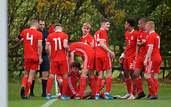 WREXHAM, WALES - Wednesday, October 30, 2019: Wales' Christopher Popov celebrates scoring the second goal with team-mates during the 2019 Victory Shield match between Wales and Republic of Ireland at Colliers Park. (Pic by David Rawcliffe/Propaganda)