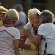 Joan Bak, Canada, and Rita Price, USA, congratulate Gold medal winners,  Jutta Apel, Germany, and Elsie Crowe, after the 80 Womens Doubles Final  during the 2009 ITF Super-Seniors World Team and Individual Championships at Perth, Western Australia, between 2-15th November, 2009.