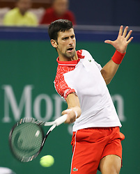 SHANGHAI, Oct. 9, 2018  Serbia's Novak Djokovic hits a return during the men's singles second round match against France's Jeremy Chardy at the Shanghai Masters tennis tournament on Oct. 9, 2018. Novak Djokovic won 2-0. (Credit Image: © Ding Ting/Xinhua via ZUMA Wire)