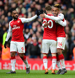 Pierre-Emerick Aubameyang of Arsenal celebrates with Shkodran Mustafi of Arsenal - Mandatory by-line: Alex James/JMP - 01/04/2018 - FOOTBALL - Emirates Stadium - London, England - Arsenal v Stoke City - Premier League