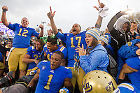 17 October 2012: Quarterback (17) Brett Hundley of the UCLA Bruins with teammates (12) Richard Brehaut and (1) Shaquelle Evans celebrate after defeating the USC Trojans 38-28 at the Rose Bowl in Pasadena, CA.