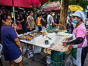 07 NOVEMBER 2017 - BANGKOK, THAILAND: A couple that sells pa tong go (Chinese friend dough, like a Chinese churro or donut) at a local market on Ekkamai Soi 30 in Bangkok.      PHOTO BY JACK KURTZ