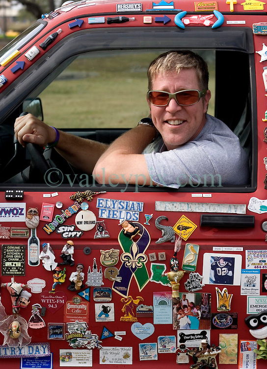 04 Jan, 2006. New Orleans, Louisiana.  Post Katrina aftermath.<br /> Magnet man Chris Cressionnie  with his 1994 Chevy Blazer. Chris traversed New Orleans after the hurricane collecting fridge magnets from all the discarded fridges left abandoned and stinking in the streets. He now has a collection of thousands of magnets and residents continue to donate magnets as do people from all across the USA.<br /> Photo; &copy;Charlie Varley/varleypix.com