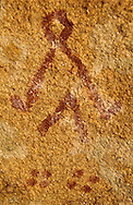 This pictograph carries multiple meanings.  ONe is a stylized figure of a dwelling in the form of a man; the dewelling resembles a Teepee.  The pictography is done in a technique called Pisanitsy using ocher.  It dates to the Eneolitic period in Kazakhstan (c. 4,000  to 3,000 B.C.) between the stone and the bronze ages.  It was found at Akbaur Grotto in Eastern Kazakhstan.