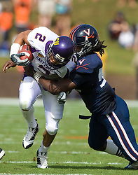 Virginia linebacker Antonio Appleby (58) brings down East Carolina running back Jonathan Williams (2).  The Virginia Cavaliers defeated the East Carolina Pirates 35-20 in NCAA football at Scott Stadium on the Grounds of the University of Virginia in Charlottesville, VA on October 11, 2008.
